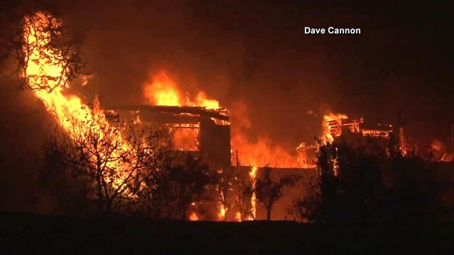 A building in Calistoga, California is consumed by flames from the Tubbs wildfire. (Dave Cannon via NBC News)