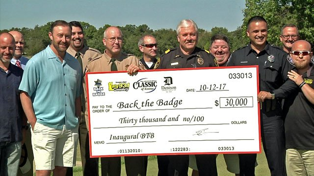 Local police agencies accept a $30,000 check from the Back the Badge Golf Tournament. (KTEN)