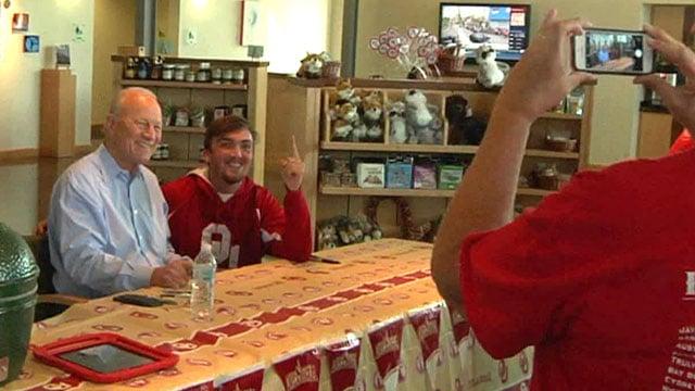 Legendary Oklahoma Coach Barry Switzer obliges a fan with a photo. (KTEN)