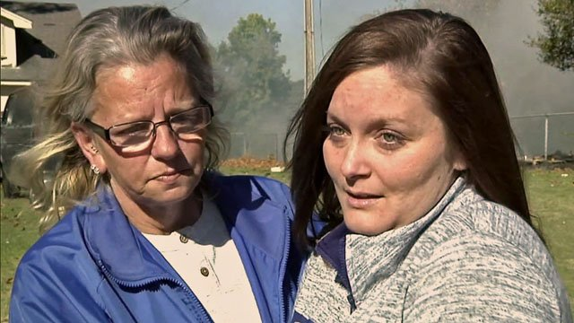 Sasha Webb, right, pulled two neighbors from the fiery rubble of their home. (KTEN)