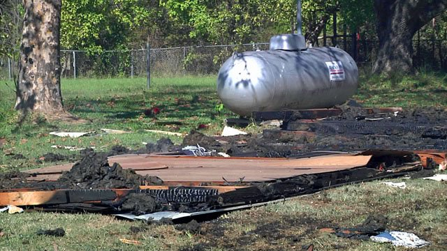 A propane tank appears to be undamaged at the site of the Mead explosion. (KTEN)