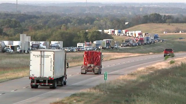 Traffic on I-35 was backed up for miles after a fiery 18-wheeler crash in Love County late Wednesday afternoon. (KTEN)