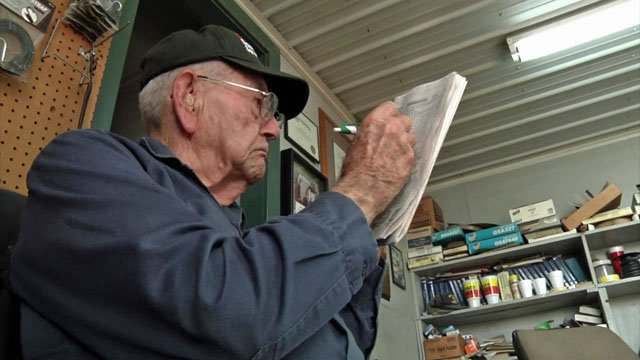 Bowles Station proprietor Nelson Bowles works on a puzzle. (KTEN)