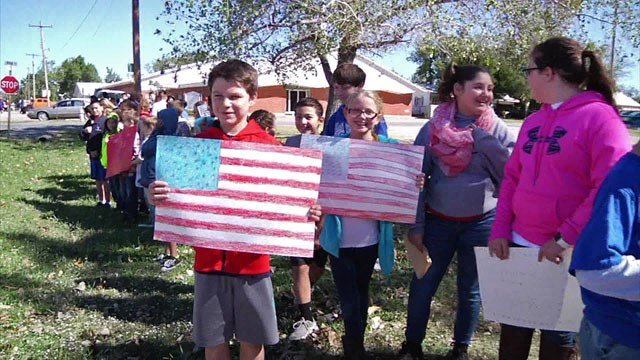 Calera students and teachers cheered service members who are being deployed. (KTEN)