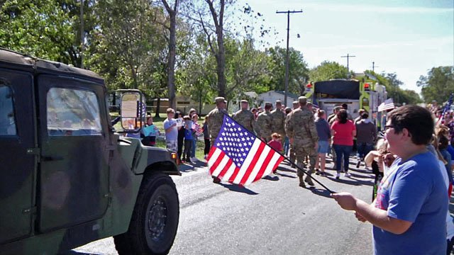 Flags were waving in Calera as the community gave a big sendoff to service members being deployed. (KTEN)