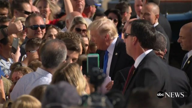 President Trump greets the crowd at Dallas Love Field Airport. (ABC News)
