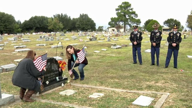 Flags are placed at the grave of U.S. Army Staff Sgt. Michael Shank in Bonham. (KTEN)