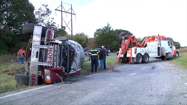 Troopers said the driver of this cement truck was going too fast when it flipped on its side. (KTEN)