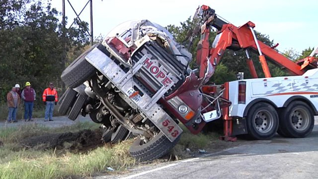 A heavy duty wrecker was used to get the cement mixer upright. (KTEN)