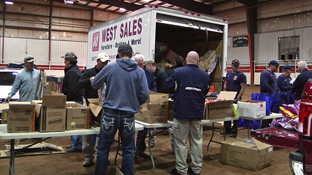 First responders get treats ready for the Halloween Safe House in Ada. (KTEN)