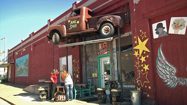 There's an old pickup truck over the entrance to Junk Stars. (KTEN)