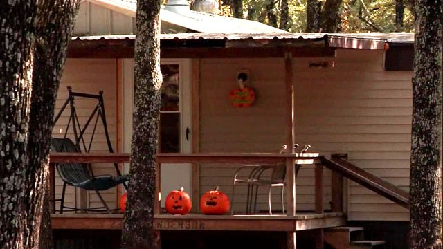 Halloween pumpkins on the porch of the home on Forest Lane Drive where two young girls were shot and killed early Wednesday. (KETK)