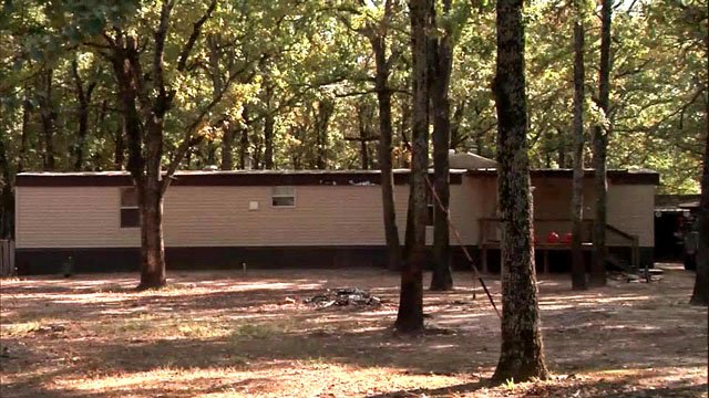 Deputies found 5 and 7 year-old girls shot dead at this mobile home near Mabank. (KETK)