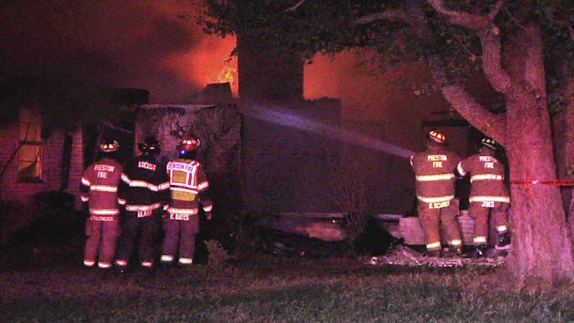 Firefighters battle a house fire in the 5800 block of Helen Drive in Denison. (KTEN)