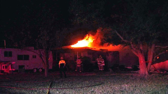 A house in the 5800 block of Helen Drive in Denison burns. (KTEN)