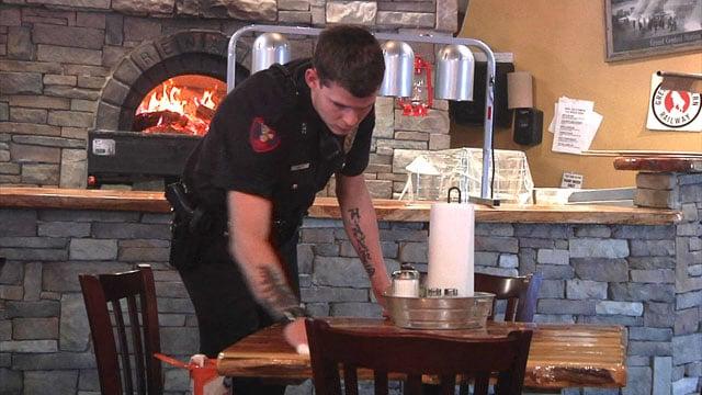 Uniformed Madill police officers were the servers at Hobo Joe's. (KTEN)