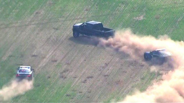 The driver of a pickup truck led police through fields. (KFOR)