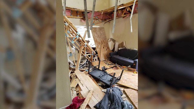 Aftermath of the floor collapse at a Denton apartment building. (KTVT via CNN)
