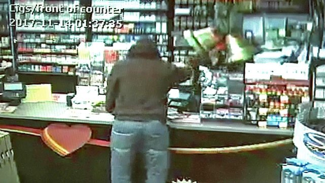 A man displayed a gun and demanded cash at the Love's Country Store in Madill early Tuesday. (Surveillance photo)