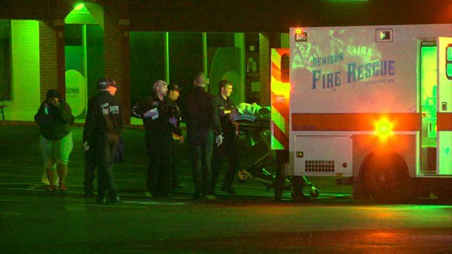 Denison paramedics take one of the young shooting victims to the hospital. (KTEN)