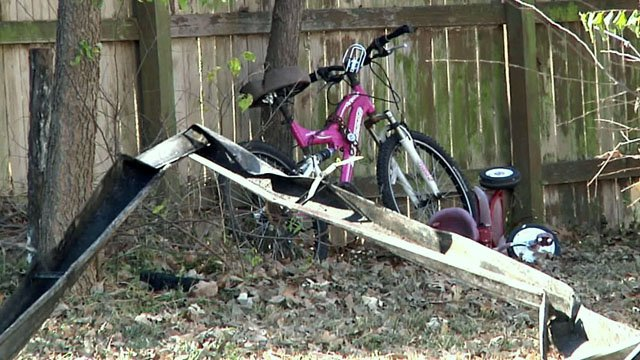 Children's bicycles in the yard of a Gainesville home that burned on Monday morning. (KTEN)