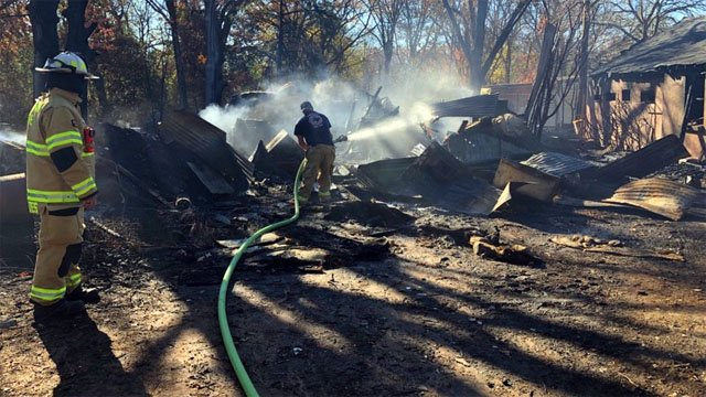 Firefighters doused hot spots at the scene of a house fire in Pottsboro. (KTEN)