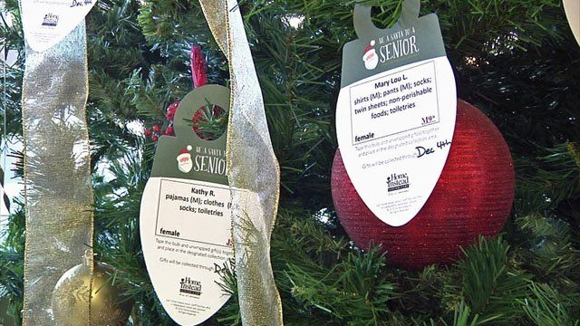 Ornaments invite shoppers to Be a Santa for a Senior. (KTEN)