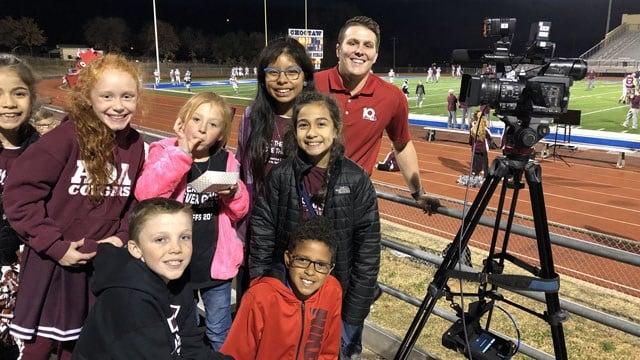 KTEN's Brendan Agans with Ada fans before Friday's big game. (KTEN)