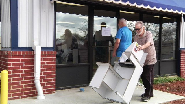 Equipment is removed from the OneSource Pharmacy in Calera. (KTEN)