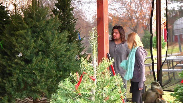 Kimberlie and Caynan Copeland are sold on the scent of a real Christmas tree. (KTEN)