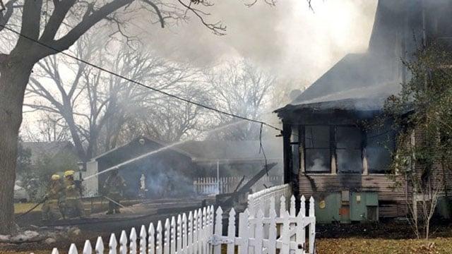 Van Alstyne firefighters battled a stubborn fire at a historic residence on Umphress Street. (KTEN)