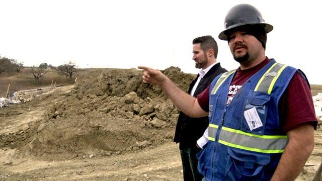 Sherman City Council member Shawn Teamann, left, surveys the Sherman Corners development site. (KTEN)