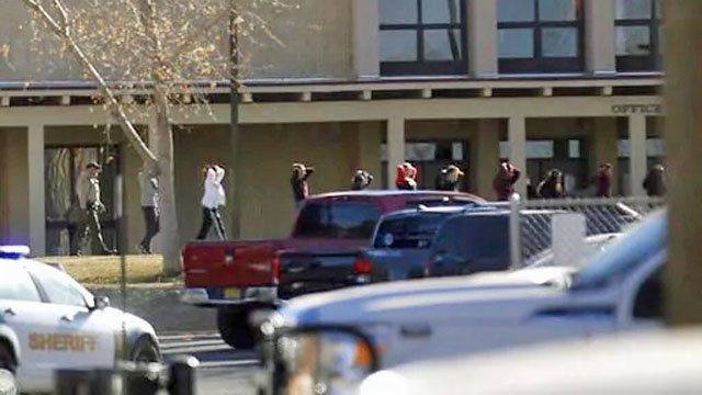 Students are escorted out of Aztec High School after Thursday's shooting incident. (Jon Austria/The Daily Times via AP)