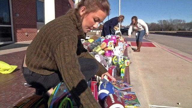 Van Alstyne High School senior Dakota Kern gets donated toys ready for pickup. (KTEN)