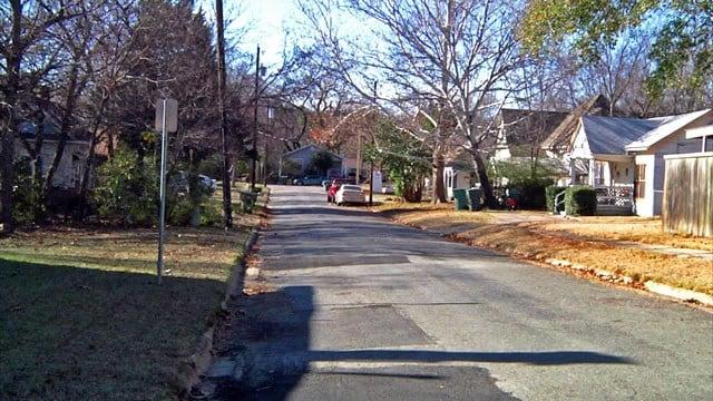 Neighbors heard gunfire along this normally quiet Sherman street on Sunday night. (KTEN)