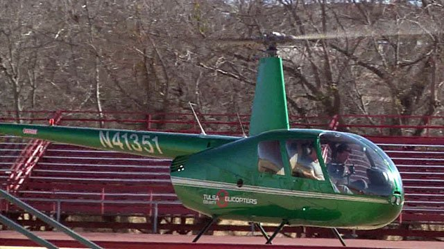 OSU head coach Mike Gundy dropped in on a top Sulphur High School recruit by helicopter. (KTEN)