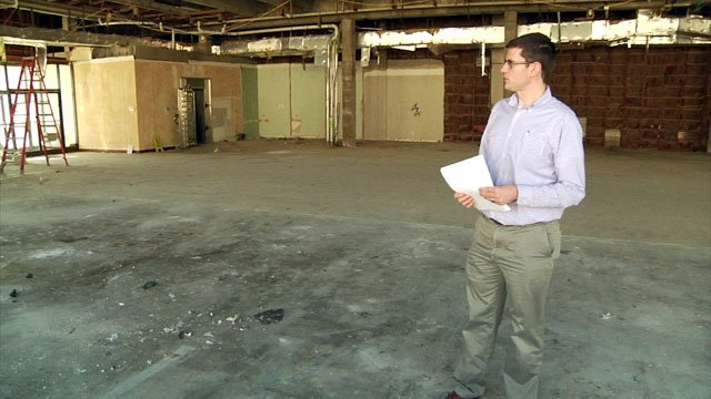 Denison Director of Development Services Gabe Reaume surveys the space that will soon be City Hall. (KTEN)