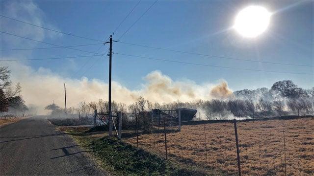 Smoke rises from a grass fire along Ranchette Road in Mead, Okla. (KTEN)