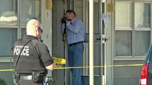 Denison police detectives collect evidence at the scene of a suspected homicide. (KTEN)