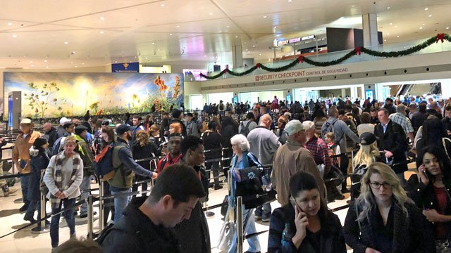 By midday Friday, Dallas Love Field departing passengers faced a 45-minute wait for security checks. (KTEN)