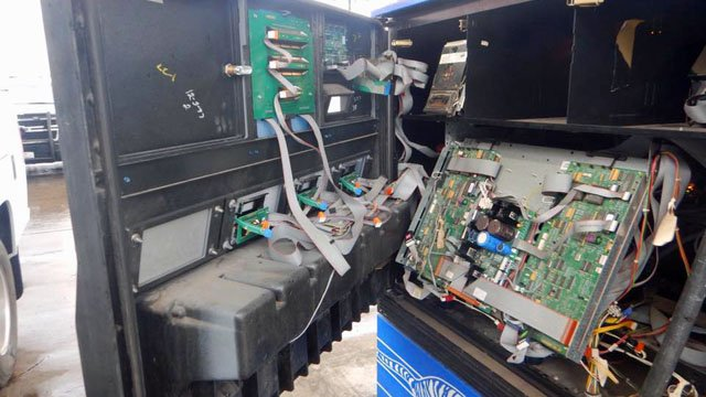 """A technician found two credit card """"skimmers"""" had been installed in gas pumps at a Sherman Exxon station. (Sherman PD/Facebook)"""