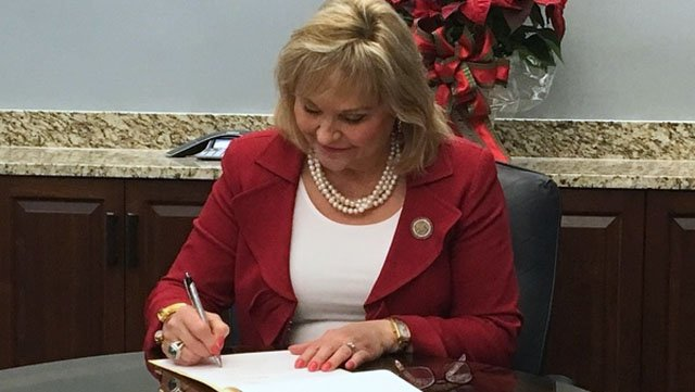 Gov. Mary Fallin signs funding bills on December 22, 2017. (Photo courtesy Governor's office)
