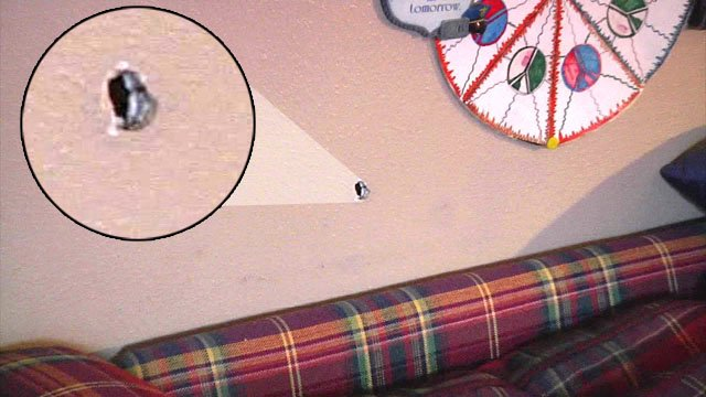 A bullet punctured the wall of a home on B Street NW in Ardmore. (KTEN)
