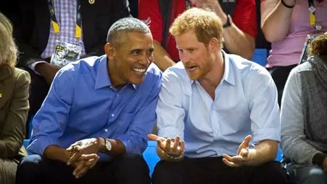 Former U.S. President Barack Obama and Britain's Prince Harry watch wheelchair basketball at the Invictus Games in Toronto on September 29, 2017. (Chris Donovan/The Canadian Press via AP)