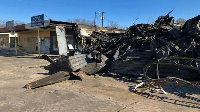Fire destroyed a former Sherman convenience store on New Year's Eve. (KTEN)