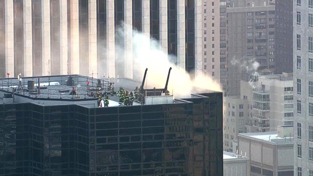 New York firefighters attack a blaze atop Trump Tower. (NBC News)