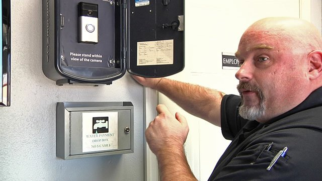 Tom Bean police Chief Tim Green demonstrates the department's new video call box. (KTEN)