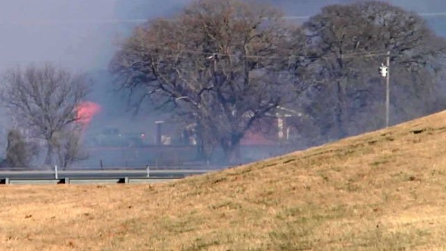 A structure on fire along Interstate 35 in Love County, Oklahoma. (KTEN)