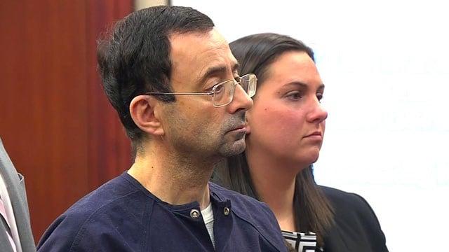 Former sports doctor Larry Nassar is sentenced in Lansing, Michigan. (CNN)