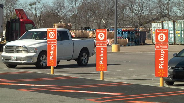 Designated pickup spaces are being installed at Walmart's Ardmore store. (KTEN)